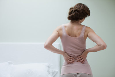 Illustration of Back Pain Accompanied By Difficult BAK?