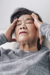 Illustration of Back Headache Accompanied By Red Eyes, Cold Feet And Nausea.?