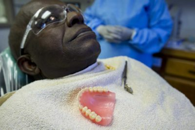 Illustration of Install Dentures Even Though They Have Been Toothless For Years.?