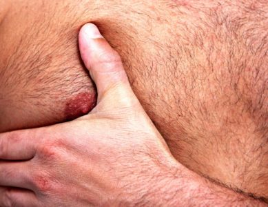 Illustration of Pain In The Back Of A Man's Nipples?
