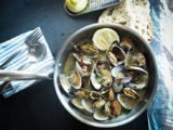Causes Vomiting After Consumption Of Clams And Squid?