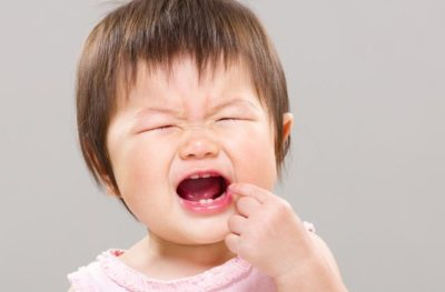 Illustration of The Child's Gums Are Bleeding After Hitting The Door?