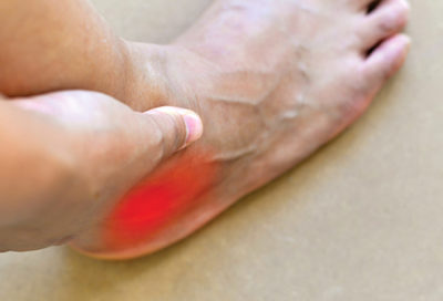 Illustration of How To Deal With Pain In The Right Ankle Due To Needle Sticking?