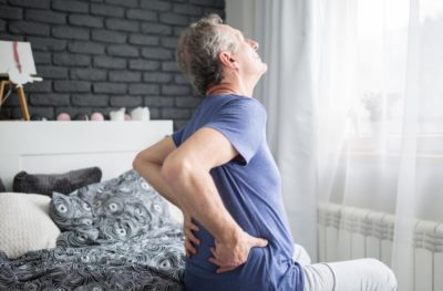 Illustration of Back Pain Every Time You Wake Up And Achy Legs If You Sit Too Long?